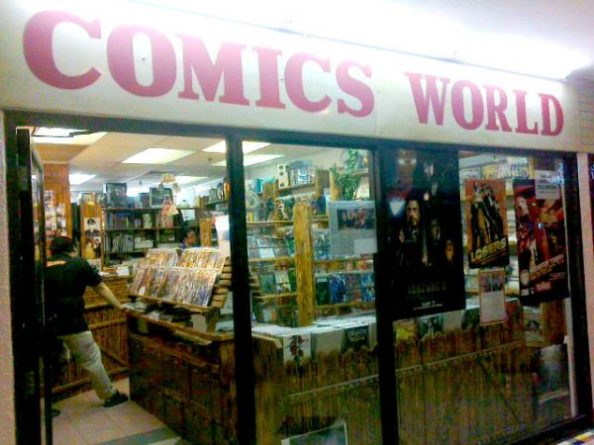 Uncle Bill standing amongst the rows of comics at Comics World