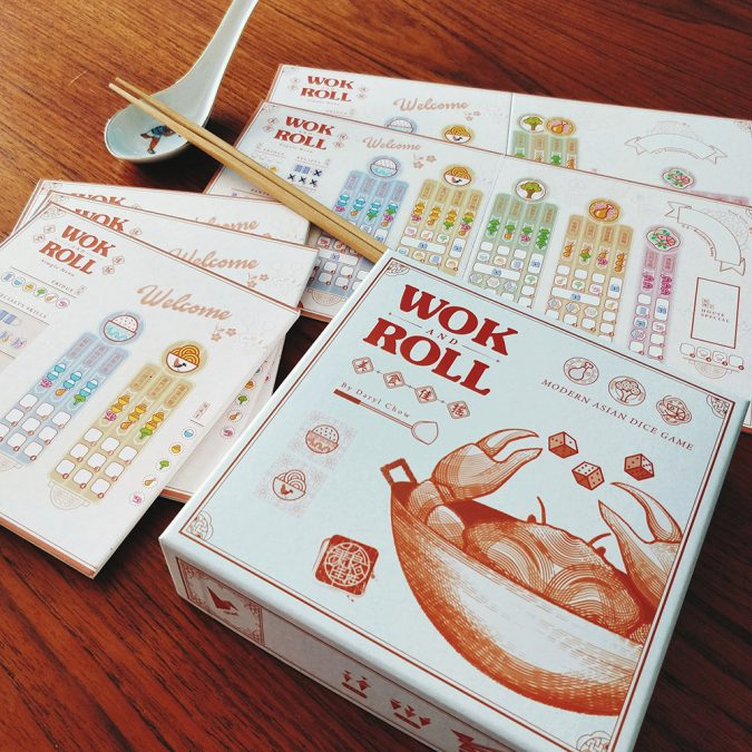An overview shot of Singaporean board game, Wok and Roll, and its contents.
